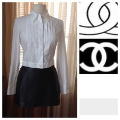 Chanel white cotton blouse Worn probably just once. Like new. Size tag got cut off but this is a size small. Buttons are engraved chanel and one is engraved with the logo. Please see photos.  End of sleeves are  designed for cuff links instead of buttons.                                                    d CHANEL Tops Blouses