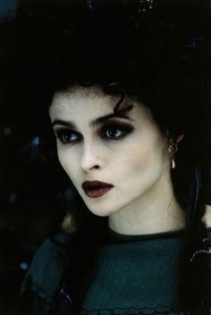 With heavy eye shadow and lipstick in dark shades of red, Helena Bonham Carter epitomises the goth