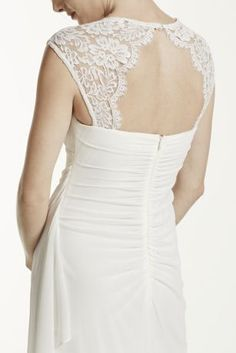 You will look breathtaking in the timeless and chic wedding dress!  Empire bodice features ultra-feminine lace cap sleeves and eye-catching open back detail.  Sheer matte mesh dress with side drape mesh skirt is accented with a cascade which adds dimension and creates a long and soft silhouette.  Mesh wrap included.   Fully lined. Back zip. Imported polyester. Dry clean only.  To protect your dress, try our Non Woven Garment Bag.  Available in Plus ...