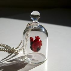 """""""Nobody likes a broken heart, so we have constructed this one from durable borosilicate glass- the same kind of glass used in scientific labs. The jar is a completely sealed vacuum, and does not open.""""  $82."""
