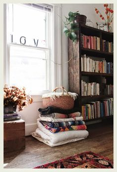 some blankets can be stored as part of the decor, or in a pretty basket - library or family room.