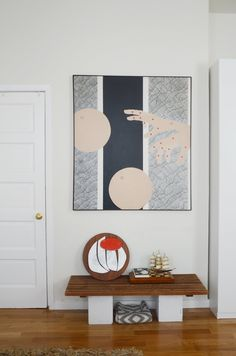 The abstract hand painting was purchased from Objects USA