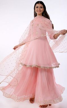Light Pink Gota Patti Frock Style Sharara Set Description: Golden Gota Patti floral motifs sprinkled all-over the bodice Three-quarter sleeves Boat neck with pintucks detailing in the centre front A-line short Kurti Pattern with gota lace b Sharara Designs, Kurta Designs Women, Kurti Designs Party Wear, Short Kurti Designs, Dress Designs, Pakistani Dresses Casual, Pakistani Dress Design, Pakistani Gowns, Shadi Dresses