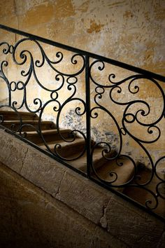 Love the wrought iron scroll work for the staircase. Cottage Hallway, Burglar Bars, Spanish Home Decor, Under The Tuscan Sun, Take The Stairs, Grand Staircase, Old Stone, Stair Railing, French Country Decorating
