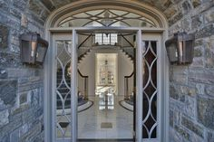 The home's stone front porch cascades into a two-story foyer with a gorgeous double staircase. The foyer boasts luxurious marble floors for a grand first impression.