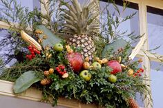 Pineapple motifs: The popular 18th-century design motif—a symbol of hospitality found in architectural details, furniture, gardens, and more—becomes a standout centerpiece in holiday decorations. | Photo: Courtesy of Colonial Williamsburg Foundation