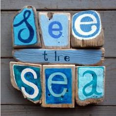 Driftwood wall art...I'm not so fussy on the painted driftwood, but I like the words.