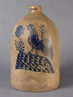 """Keno Auctions.  1/18/11.  Lot 39. Description: Salt-Glazed Cobalt-Blue Decorated Stoneware Jug with Rooster on Checkerboard Decoration  impressed """"W.H. FARRAR  CO GEDDES N.Y."""".  19th Century.  14 1/8"""" h.  Condition Report: It is repaired at juncture of handle to the spout, as well as an overall discoloration to the glaze."""