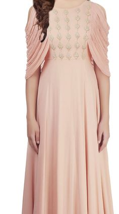 Beautiful Peach and Georgette indowestern Gown is part of Indowestern gowns - Buy Beautiful Peach and Georgette indowestern dress which is ornamented with a Sequins work on the yoke part which is increasing its prettiness Best indowestern gown Designer Party Wear Dresses, Kurti Designs Party Wear, Indian Designer Outfits, Designer Gowns, Long Dress Design, Stylish Dress Designs, Stylish Dresses, Fashion Dresses, Sleeves Designs For Dresses