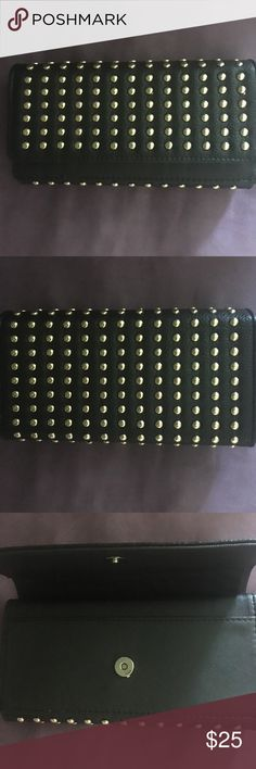 Studded black double fold leather wallet This is a studded black leather double fold wallet. It has a flap that opens to one compartment and other flap that opens to credit cards compartment, along with a compartment for bills. I only wore it twice and it's in excellent condition.🌹🍭🙂 Bags Wallets