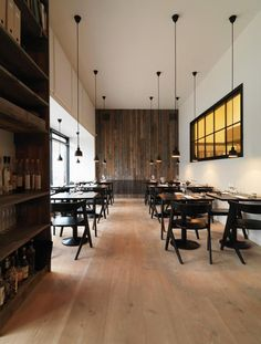 reclaimed wood planks, Tom Dixon slab chairs, Dinesen Douglas floor.Restaurant Radio.