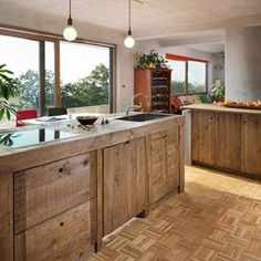 A stunning kitchen remodel created with pallets! Take a tour and check out 5 detailed tips and ideas on how to work with pallets in a kitchen remodel!