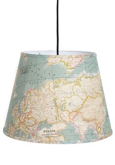 Light Up the World Pendant Lamp. You aim to explore the unknown, so you were drawn to this hanging lamp with its unique map-printed lightshade! #multi #modcloth