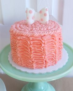 pink ruffle cake with a cute little polka dot bow