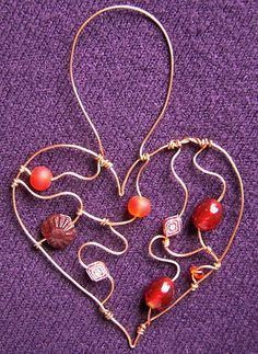 Red Heart - a beaded suncatcher glass beads: http://www.ecrafty.com/c-2-glass-beads.aspx