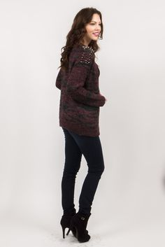 Show off your soft side, with a little bit of punk.  Our oversized burgundy and gray pattern sweater cardigan features stud shoulder accent, front pockets, and 5 wood button closures.  Made of wool, this stylish cardigan will keep you nice and warm while not making you itchy (because it is SUPER soft)!  Shown styled with Pure Dark Mid Rise Super Stretchy Skinny Jean by Eunina Jeans and Basic Black Body Suit Underneath.