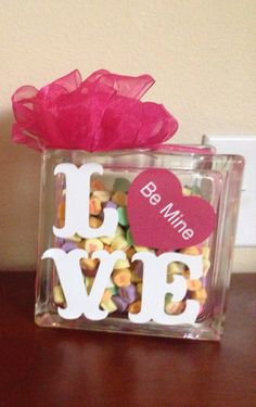 Valentine's Day decoration-used a glass block, vinyl letters, ribbon & candy hearts