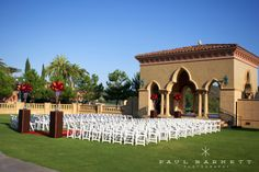Gorgeous red and white wedding ceremony at the Grand Del Mar. Luxury Wedding Photography by photographer Paul Barnett.