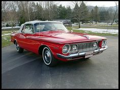 """1962 Plymouth Sport Fury convertible in """"cherry red"""" with white top."""