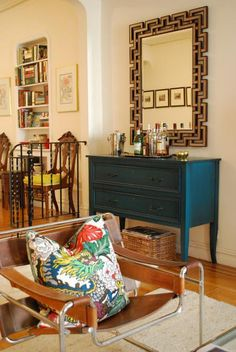 navy blue sideboard, gold mirror, and one of my favorite chairs and pillow fabric