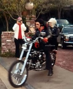 Elvis and Priscilla, leaving 1174 Hillcrest, in Beverley Hills on his Harley chopper- 1971 Source IG thekingelviss