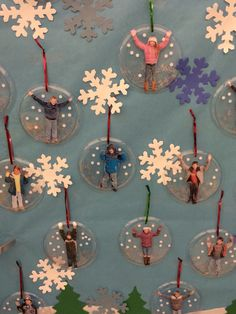 Close up of snow globes make with clear plastic plates, modge podge silver glitter and hole punch white paper. Fun and easy Christmas ornament