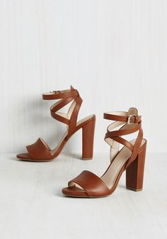 These beautiful, faux leather heels are so versatile, you'll be able to mold them into any look you can imagine! Decorated with crisscrossing-and-wrapping ankle straps, peep toes, and a tawny brown hue, these sweet sandals will take you from afternoon to after party with the exact style statement you seek to achieve.