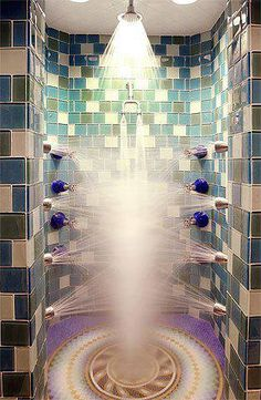 Amazing all directions shower with beautiful tile walls.