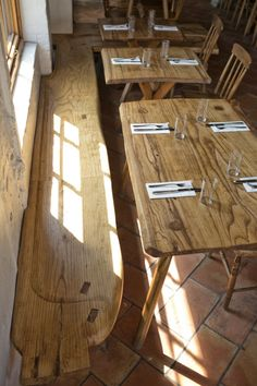 Love the rustic wooden tables and benches in this Brooklyn Restaurant.