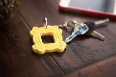 "Cool TV Props - Yellow Peephole Keychain (2.25"" x 2.25""), inspired by the one on Monica's door"