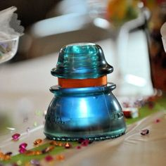 My husband is a lineman so we used insulators on every table at our Wedding. We hot glued ribbon to each an put a battery operated tea light under. Looked so cute!
