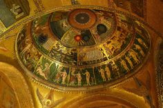 2ND GOLDEN AGE - MOSAIC: Scenes from Genesis c 1200 - Squat, large-headed figures recall the art of the 4th century as does classical young philosopher type representing Christ. Ancient art had visualized the human soul as a tiny nude figure with butterfly wings. Here this image reappears as a spirit of life that the Lord breathes into Adam. LOCATION: ST. MARK'S, VENICE