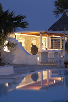Pool area at night in Palladium Hotel, Mykonos