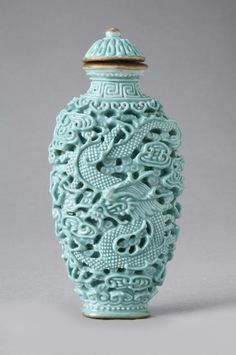 Snuff Bottle Phoenix and Dragon Artist/maker unknown, Chinese Geography: Made in China, Asia Period: Qing Dynasty (1644-1911) Date: 1770-1820 Medium: Reticulated porcelain with glazed and gilt decoration; porcelain stopper with gilded metal spoon