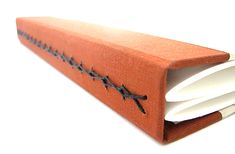 In January 2015 I embarked on a project to create 50 new book bindings by the end of the year. Below is a list of all the books that I've made so far. Book 1: Leather book with tacketed binding Book 2: Leather book with tacketed binding and packing Book 3: Long stitched felt book with...
