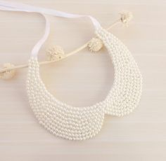http://www.etsy.com/listing/115312931/ivory-pearl-collar-necklace-peter-pan