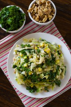 A healthy Zucchini Fettuccine with Kale recipe made with thinly sliced zucchini noodles and flavored with kale and walnuts.