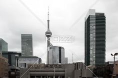 view of commercial building. - Low angle shot of office building against cloudy sky.