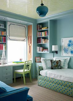 blue & green chic teen girl's bedroom (or just for meee) design with blue walls paint color, green West Elm overlapping squares chair, blue cabinets, white roman shade, blue velvet sofa, green, yellow, upholstered, bed, sconces, blue glass pendant and striped rug