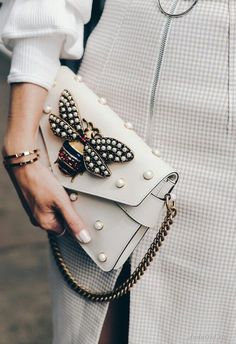 Gucci Broadway leather clutch. insect.