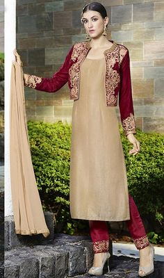 Leave the onlookers in an awe with this beige and red color velvet embroidered pant style suit. The wonderful attire creates a dramatic canvas with astounding lace and resham work. #kotystyledress #straightembroideredsuit #beigecolorsalwarkameez