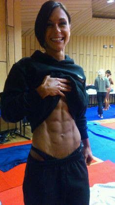 Ripped... i love how she has sweats and sweatshirt on and then you lift it up and she is ripped!! love it!!