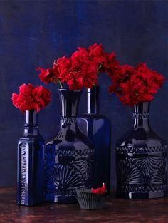 Blue Glass Vases & Red Flowers via http://thelittlecorner.tumblr.com