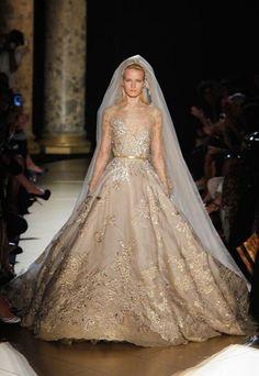 #FashionWeek  Les 10 plus belles robes de mariée Haute Couture - Elie Saab, grey with gold jacquard.
