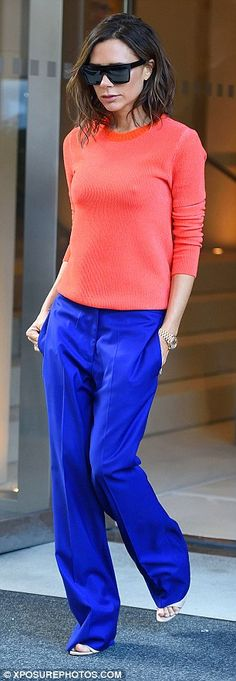 On trend:Victoria chose to colour block her ensemble by teaming the tasteful sweater with a pair of generously cut blue trousers