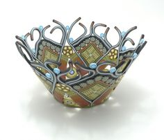Emily Squires Levine pushes what a polymer bowl can do with her recent work. Lots of open work and tendrils on this example from the Philadelphia Area Polymer Clay Guild site. Emily uses an extruder to reduce her canes!  http://www.emilysquireslevine.com/