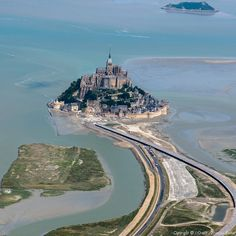 The tiny island of Mont Saint-Michel in Normandy, France, with its circumference of just 900 metres, has more than years of history under its belt. Mont Saint Michel France, Le Mont St Michel, Beautiful Castles, Beautiful Sites, Beautiful Places, Best Vacation Destinations, Best Vacations, France Vacations, Places To Travel