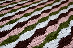 Ravelry: Wavy Blanket pattern by Stephanie Gage This particular pattern is written for a crib size blanket, but it can be easily modified to be bigger. Repeat of 12+3.