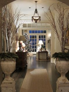 The Enchanted Home: Readers holiday homes….and it will knock your stockings of… The Enchanted Home: Readers holiday homes….and it will knock your stockings off! Christmas Home, White Christmas, Christmas Urns, Christmas Hallway, Vintage Christmas, Southern Christmas, Christmas Planters, Christmas Décor, Elegant Christmas
