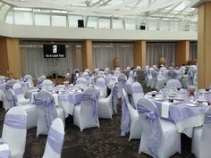 purple & white wedding reception decor